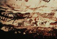Rock painting of a leaping cow and a frieze of sma