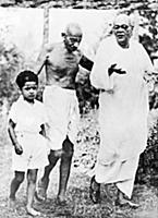 2634945 Mahatma Gandhi walking with a boy and Sara