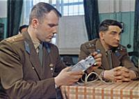 3905484 Cosmonaut Yuri Gagarin Examining an Instru
