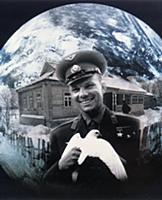 3906850 Cosmonaut Yuri Gagarin Holding a White Dov