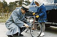 3910118 Cosmonaut Yuri Gagarin Helping his Daughte