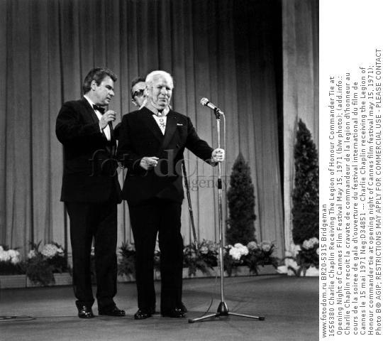 1656380 Charlie Chaplin Receiving The Legion of Honour Commander Tie at Opening Night of Cannes Film Festival May 15, 1971 (b/w photo); (add.info.: Charlie Chaplin recoit la cravate de commandeur de la legion d\'honneur au cours de la soiree de gala d\'ouverture du festival international du film de Cannes le 15 mai 1971 Neg:D34851 --- Charlie Chaplin receiving the Legion of Honour commander tie at opening night of Cannes film festival may 15, 1971); Photo В© AGIP; RESTRICTIONS MAY APPLY FOR COMMERCIAL USE - PLEASE CONTACT US;  out of copyright.