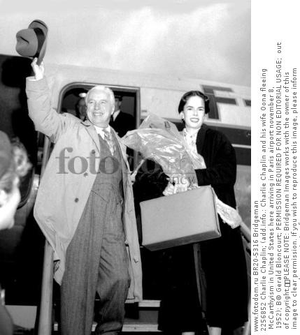 2256852 Charlie Chaplin; (add.info.: Charlie Chaplin and his wife Oona fleeing McCarthyism in United States here arriving in Paris airport november 8, 1952); В© Gerald Bloncourt; PERMISSION REQUIRED FOR NON EDITORIAL USAGE;  out of copyright.  PLEASE NOTE: Bridgeman Images works with the owner of this image to clear permission. If you wish to reproduce this image, please inform us so we can clear permission for you.