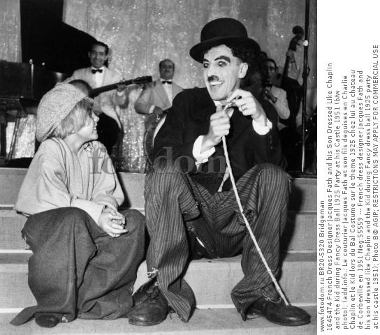 1645474 French Dress Designer Jacques Fath and his Son Dressed Like Chaplin and the Kid during Fancy Dress Ball 1925 Party at his Castle 1951 (b/w photo); (add.info.: Le couturier Jacques Fath et son fils deguises en Charlie Chaplin et le Kid lors du Bal Costume sur le theme 1925 chez lui au chateau de Corbeville en 1951 Neg:55559 --- French dress designer Jacques Fath and his son dressed like Chaplin and the Kid during Fancy dress ball 1925 party at his castle 1951); Photo В© AGIP; RESTRICTIONS MAY APPLY FOR COMMERCIAL USE - PLEASE CONTACT US;  out of copyright.