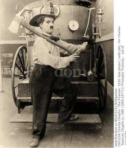 2561238 Charlie Chaplin - The Fireman. 1916 (b/w photo); (add.info.: Sir Charles Spencer Chaplin Jr., KBE (1889-1977);); Prismatic Pictures ;  out of copyright.