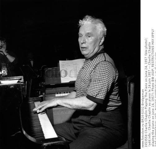 1653558 Charlie Chaplin Playing The Piano on June 24, 1957 (b/w photo); (add.info.: Charlie Chaplin au piano le 24 juin 1957 --- Charlie Chaplin playing the piano on june 24, 1957); Photo В© AGIP; RESTRICTIONS MAY APPLY FOR COMMERCIAL USE - PLEASE CONTACT US;  out of copyright.