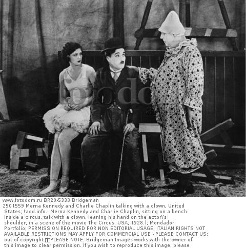 2501559 Merna Kennedy and Charlie Chaplin talking with a clown, United States; (add.info.: Merna Kennedy and Charlie Chaplin, sitting on a bench inside a circus, talk with a clown, leaning his hand on the actor\'s shoulder, in a scene of the movie The Circus. USA, 1928.); Mondadori Portfolio; PERMISSION REQUIRED FOR NON EDITORIAL USAGE; ITALIAN RIGHTS NOT AVAILABLE RESTRICTIONS MAY APPLY FOR COMMERCIAL USE - PLEASE CONTACT US;  out of copyright.  PLEASE NOTE: Bridgeman Images works with the owner of this image to clear permission. If you wish to reproduce this image, please inform us so we can clear permission for you.