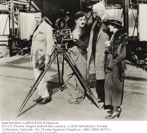 937171 Charlie Chaplin behind the camera, c.1928 (b/w photo); Private Collection; (add.info.: Sir Charles Spencer Chaplin Jr., KBE (1889-1977);); Prismatic Pictures ;  out of copyright.