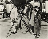 937171 Charlie Chaplin behind the camera, c.1928 (