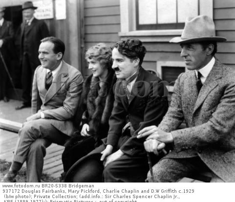 937172 Douglas Fairbanks, Mary Pickford, Charlie Chaplin and D.W Griffith c.1929 (b/w photo); Private Collection; (add.info.: Sir Charles Spencer Chaplin Jr., KBE (1889-1977);); Prismatic Pictures ;  out of copyright.