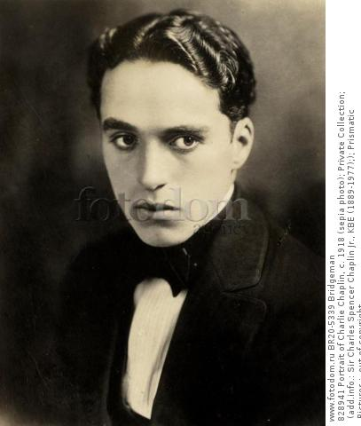 828941 Portrait of Charlie Chaplin, c. 1918 (sepia photo); Private Collection; (add.info.: Sir Charles Spencer Chaplin Jr., KBE (1889-1977);); Prismatic Pictures ;  out of copyright.