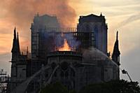 Smoke billows from Notre Dame Cathedral after a fi