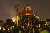 Firefighters douse flames from the burning Notre D