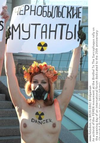 An activist of the FEMEN movement at the Brothel To The Sarcophagus rally on the opening day of an international forum dedicated to the 25th anniversary Chernobyl disaster in Kiev, 2011 (photo)