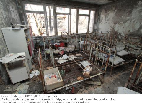 Beds in a kindergarten in the town of Pripyat, abandoned by residents after the explosion at the Chernobyl nuclear power plant, 2011 (photo)