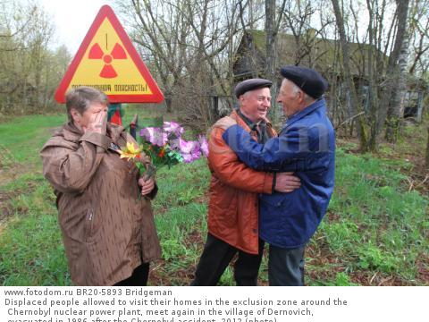 Displaced people allowed to visit their homes in the exclusion zone around the Chernobyl nuclear power plant, meet again in the village of Dernovich, evacuated in 1986 after the Chernobyl accident, 2012 (photo)