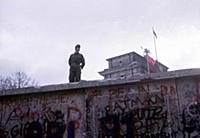 Fall of the Berlin Wall: a miltaire on the Wall. N