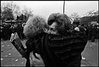 Two Berliners embrace with joy following the openi