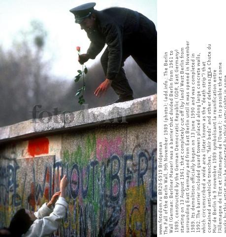 The Fall of the Berlin Wall, 9th November 1989 (photo); (add.info.: The Berlin Wall (German: Berliner Mauer) was a barrier that divided Berlin from 1961 to 1989, constructed by the German Democratic Republic (GDR, East Germany) starting on 13 August 1961, that completely cut off (by land) West Berlin from surrounding East Germany and from East Berlin until it was opened in November 1989. Its demolition officially began on 13 June 1990 and was completed in 1992. The barrier included guard towers placed along large concrete walls, which circumscribed a wide area (later known as the 'death strip') that contained anti-vehicle trenches, 'fakir beds' and other defenses.  La Chute du Mur de Berlin le 9 novembre 1989 symbolisant la reunification entre l'Allemagne de l'Est et l'Allemagne de l'Ouest );  it is possible that some works by this artist may be protected by third party rights in some territories.