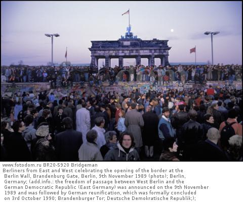 Berliners from East and West celebrating the opening of the border at the Berlin Wall, Brandenburg Gate, Berlin, 9th November 1989 (photo); Berlin, Germany; (add.info.: the freedom of passage between West Berlin and the German Democratic Republic (East Germany) was announced on the 9th November 1989 and was followed by German reunification, which was formally concluded on 3rd October 1990; Brandenburger Tor; Deutsche Demokratische Republik;); .