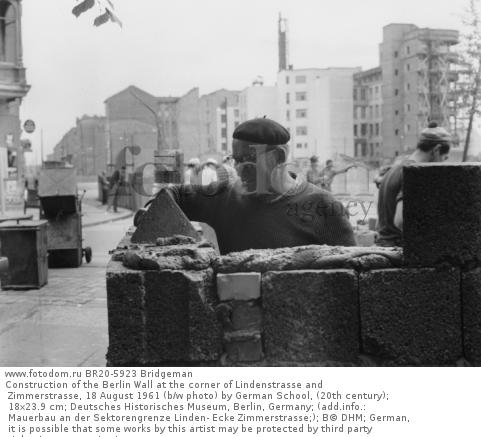 Construction of the Berlin Wall at the corner of Lindenstrasse and Zimmerstrasse, 18 August 1961 (b/w photo) by German School, (20th century); 18x23.9 cm; Deutsches Historisches Museum, Berlin, Germany; (add.info.: Mauerbau an der Sektorengrenze Linden- Ecke Zimmerstrasse;); В© DHM; German,  it is possible that some works by this artist may be protected by third party rights in some territories.