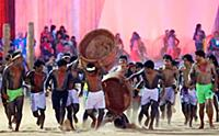 The Gaviao people log bearer falls as they perform