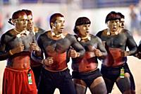 The Xavanti people perform a victory dance after w