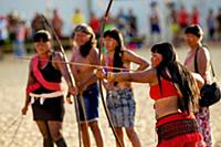 Woman demonstrate bow and arrow at the first World