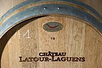 Barrique in cellar of Chateau Latour-Laguens  Sain