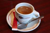 Cup of espresso coffee on a cafe table  Paris  Fra
