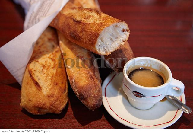 Cup of espresso coffee with baguettes on a cafe table. Paris  France.