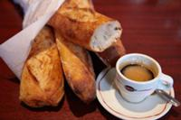 Cup of espresso coffee with baguettes on a cafe ta