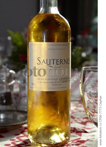 Bottle of Sauternes on a dining table at Christmas. France.