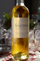 Bottle of Sauternes on a dining table at Christmas