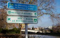 Signs for cycle routes by the River Marne.  Le Per
