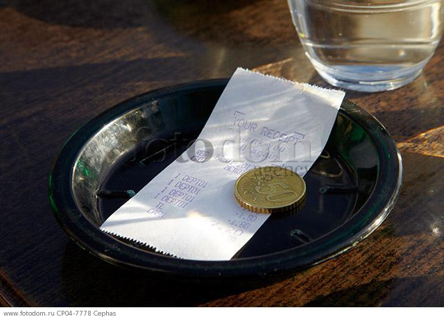 Receipt (in English) and 50 cent coin on table of a Paris cafe. Paris  France.