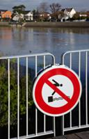 'No Diving' sign on jetty by the River Marne. Le P