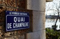 Sign for Quai de Champagne and flood marker by the