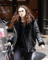 Actress Keira Knightley wears a sheepskin flying j