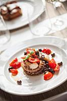 Polpo con pomodorini e olive (octopus was cherry t