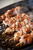 Veal kebabs being fried