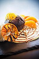 Chocolate orange cake on orange cream with whipped