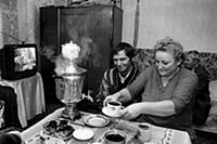 Man and woman making tea with a samovar.  Vazhini,