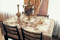 Rosskazovka, Russia: Tea samovar on table. ©Jeff G