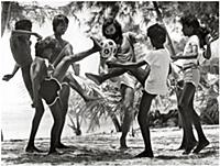 George Best plays barefoot beach football with loc