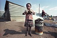 Picture by Roger Bamber : Barefoot Township kid in