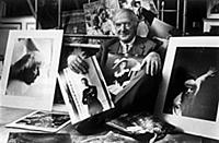 Cecil Beaton in the 1960s with some of his portfol