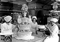 Icing a wedding cake at CWS Limited, Biscuit Works