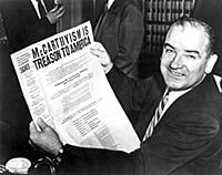 Senator Joe McCarthy grins boldly during a recess