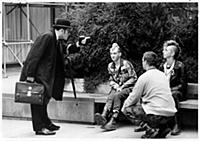 A city worker confronts a group of punks during a